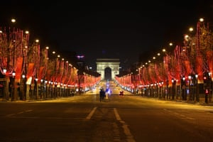 The Champs Elysee in Paris is quiet during a night-time curfew. Restaurants, cafes, theatres and cinemas remain closed