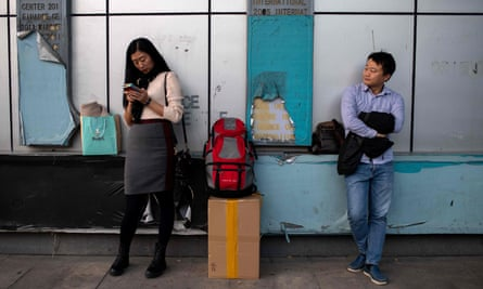"People wait for a bus on the eve of the 40th anniversary of China's ""reform and opening up"" policy in Shenzhen."