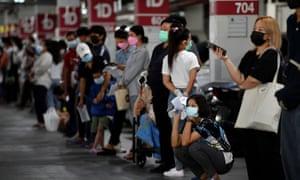 People queue for free coronavirus tests in Bangkok, Thailand