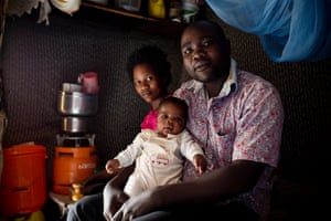 Jacqueline and James Onyango with their baby Wesley at their home in Kibera