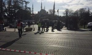 Police guard the scene of the blast