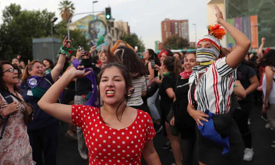 Demonstrators take part in a protest marking the National Day Against Femicide in Santiago in December.
