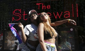 Celia Gooding, left, and Laila Kelly pose for a picture in front of the Stonewall Inn before the Queer Liberation March.