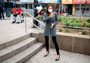 Alexandria Ocasio-Cortez wears a face mask for protection against the coronavirus, as she arrived for a press conference yesterday in New York, alongside Senate Minority Leader and fellow New Yorker Chuck Schumer.