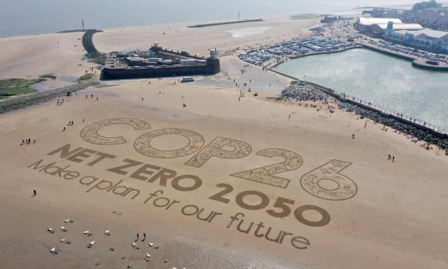 A sand artwork highlighting the upcoming Cop26 global climate conference in Wirral, Merseyside, May 2021