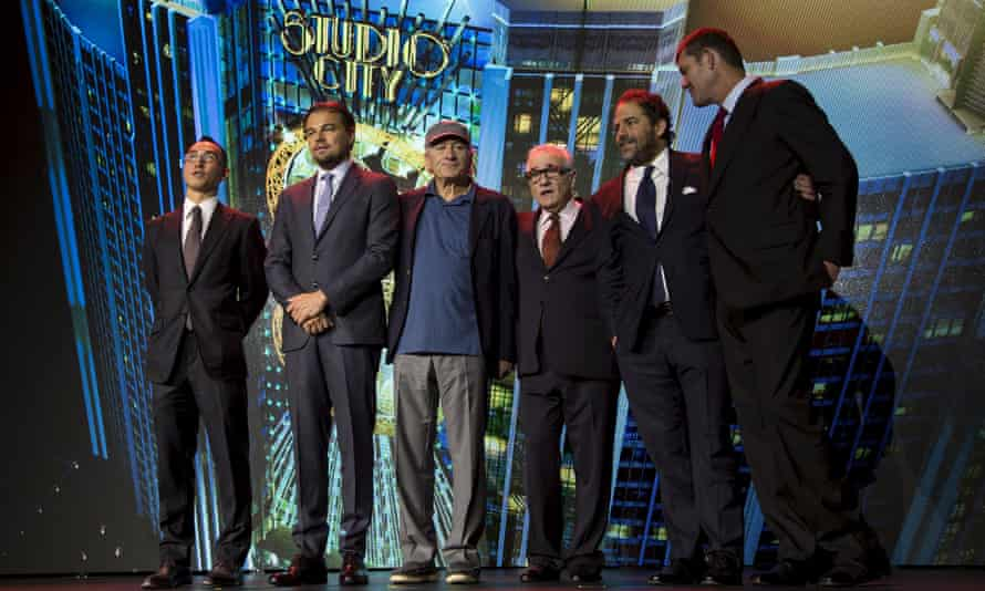 Lawrence Ho, Leonardo DiCaprio, Robert De Niro, Martin Scorsese, Brett Ratner and James Packer pose for photos after a news conference for the short film The Audition in Macau, China.