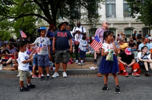 Children wave US flags
