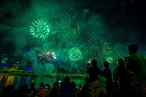 People watch fireworks ahead of New Year's Eve over the Brisbane River at Southbank in Brisbane