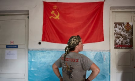A communist flag on a wall inside the rebel base.