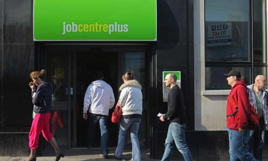 People wait outside a jobcentre in Bristol
