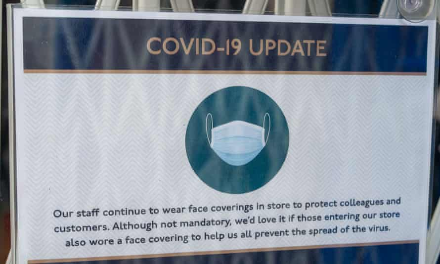 A notice in a sports shop window in Eton High Street requesting people to still wear face masks