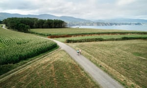 Aerial view of a couple practicing cycling on a lonely road in the countryside