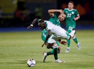 Senegal's Sadio Mane is fouled by Algeria's Djamel Benlamri.