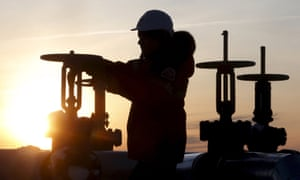 A worker checking an oil pipe valve at Lukoil company owned Imilorskoye oil field outside West Siberian city of Kogalym.