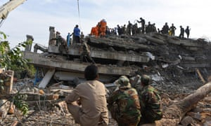 Rescuers search for survivorsof the building collapse in Kep, Cambodia