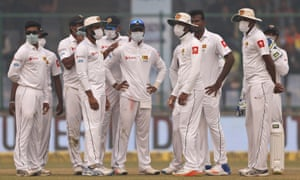 Sri Lanka's players wear anti-pollution masks during the third Test against India in Delhi.
