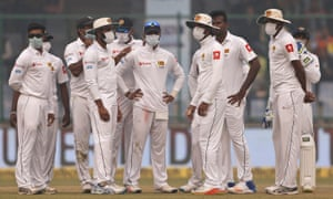 Sri Lanka's players wear anti-pollution masks during the match in Delhi.