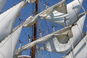 Close up of sailors standing on masts