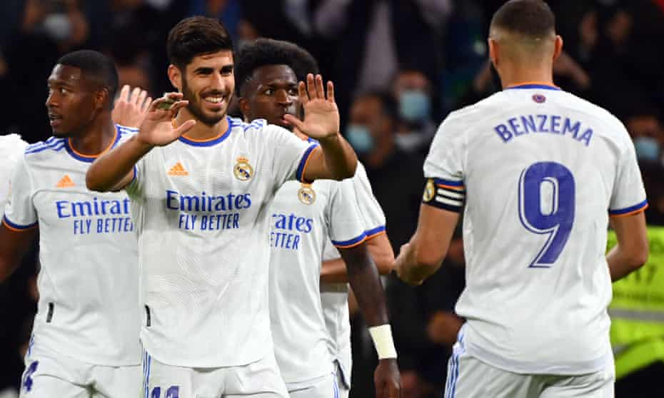 Marco Asensio celebrates his hat-trick and goes to his Real Madrid teammate Karim Benzema.