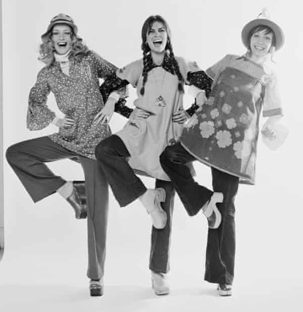 English actor Caroline Munro with fashion models Nikki Ross wear clogs in 1972.