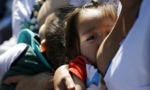 Women breastfeed babies during an event, at Chapultepec Park in Mexico City