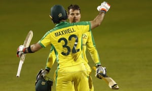 Australia's Alex Carey is congratulated by Glenn Maxwell after reaching his century in the third ODI against England at Old Trafford