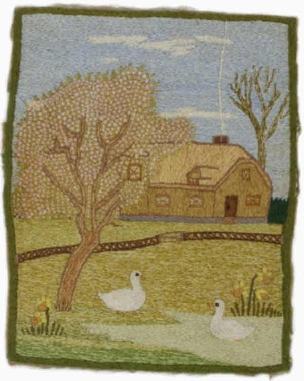 Embroidery depicting a French farmhouse, stitched by Private William George Hilton.