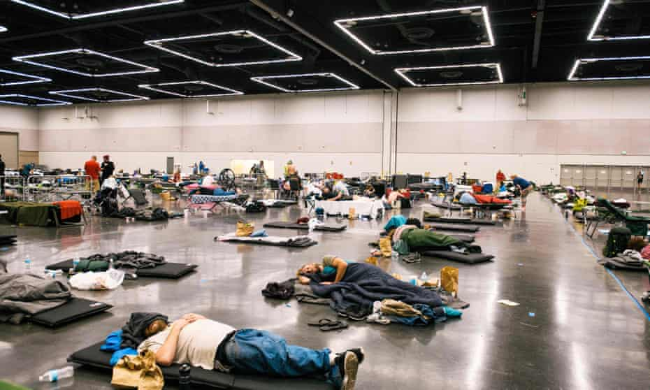 US-WEATHER<br>People rest at the Oregon Convention Center cooling station in Oregon, Portland on June 28, 2021, as a heatwave moves over much of the United States. - Swathes of the United States and Canada endured record-setting heat on June 27, 2021, forcing schools and Covid-19 testing centers to close and the postponement of an Olympic athletics qualifying event, with forecasters warning of worse to come. The village of Lytton in British Columbia broke the record for Canada's all-time high, with a temperature of 46.6 degrees Celsius (116 Fahrenheit), said Environment Canada. (Photo by Kathryn Elsesser / AFP) (Photo by KATHRYN ELSESSER/AFP via Getty Images)