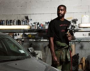Kieron Stewart, 27, mechanic, Mike's Coachworks, London N1, wears Maharishi jumpsuit in his workplace