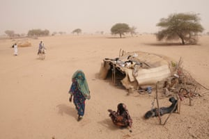 In 2012, countries across the ecologically fragile Sahel region were suffering from drought and fluctuating animal and food prices. Millions of subsistence farmers and pastoralists were affected as livestock grazing areas disappeared and desertification - caused by overgrazing and low rainfall - advanced. Here, Fatima Ibrahim Senussi (centre) and her neighbour (right) greet on arrival at their home in Andrabat, Bahr El Ghazal province, Northern Chad.