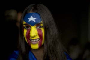 A girl with an estelada flag painted on her face