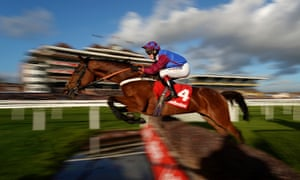 Richard Johnson and La Bague Au Roi clearing the water jump at Newbury on Friday.
