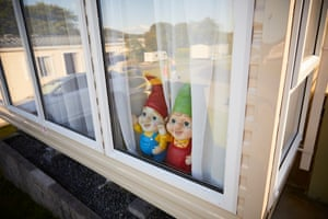 Gnomes in a static caravan window