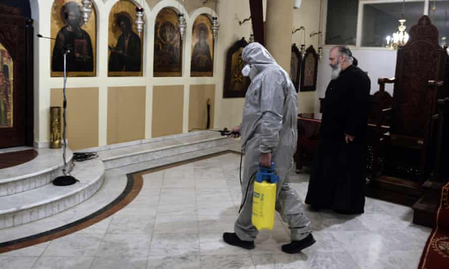 A worker disinfects a church in Thessaloniki last year