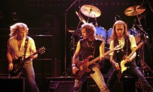 Status Quo … Alan Lancaster (centre) with bandmates Rick Parfitt (left) and Francis Rossi in 1984.