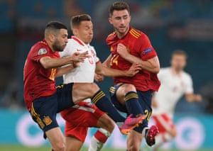 Spain's Jordi Alba (left) and Aymeric Laporte combine to thwart Poland's Przemyslaw Frankowski.