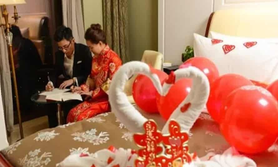 Photographs of the couple next to their balloon-covered bed were posted on social media.