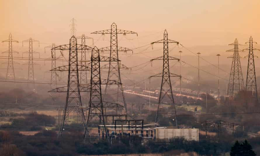 Multiple electricity pylons at sunset in Port Talbot