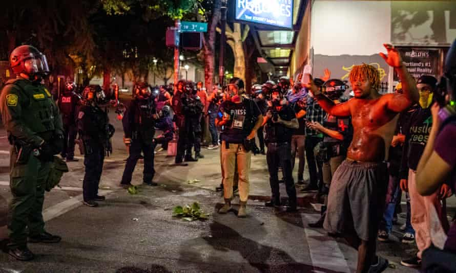 Protesters and federal agents on Wednesday night in Portland, Oregon.