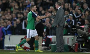 Conor Washington shakes hands with Northern Ireland manager Michael O'Neill after being substituted during their victory over Norway.