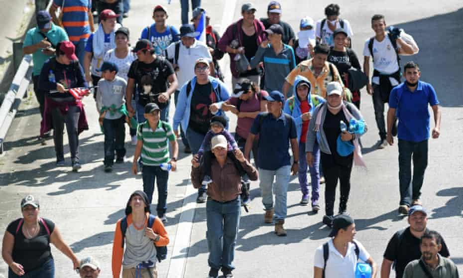 Migrants in San Salvador on 31 October.