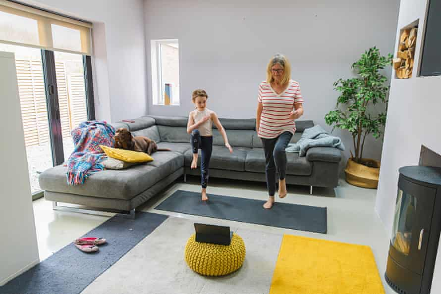 Woman and child exercising indoors