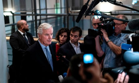 The EU's chief Brexit negotiator Michel Barnier answers journalists' questions as he arrives for a meeting at the European parliament.
