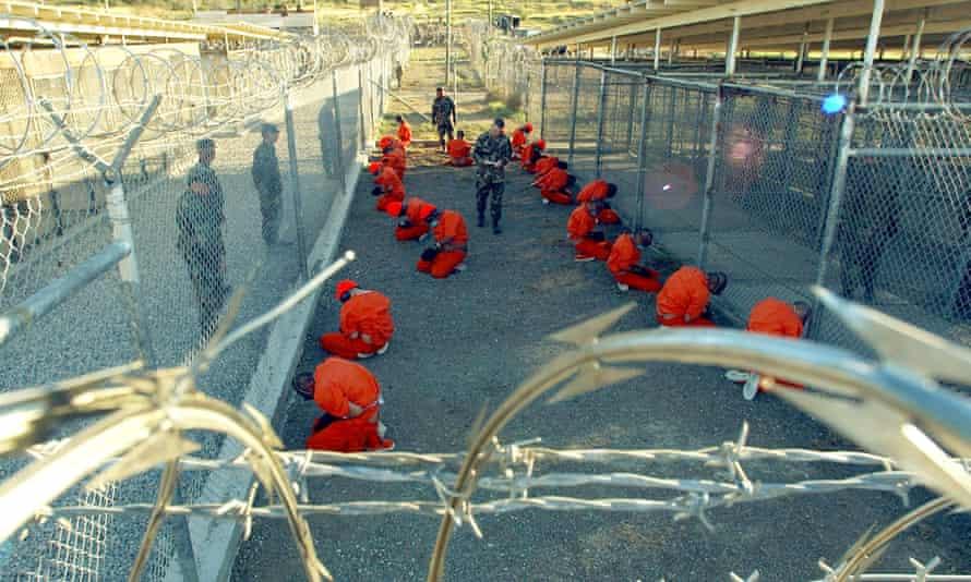 Military Police guard Taliban and al Qaeda detainees, January 11, 2002 Guantanamo Bay, Cuba