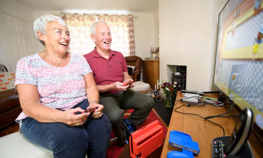 Julie and Andy Mason enjoy a video game.