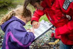 A schoolchild documents plastic found at Kilninian beach, Isle of Mull