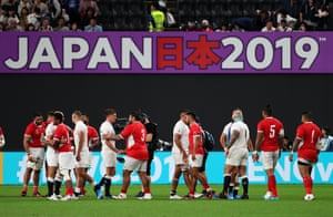 Players shake hands after England's 35-3 win over Tonga.