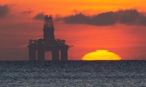The sun rises by a redundant oil platform moored off Kirkcaldy