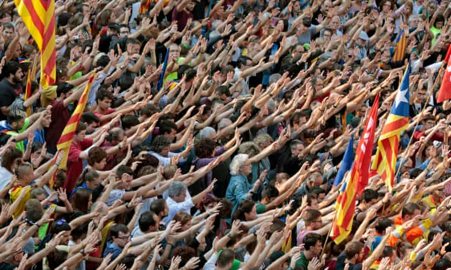 Catalans demonstrate against police violence in Barcelona, during yesterday's general strike.