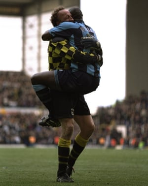 Steve Ogrizovic celebrates with Paul Williams after Coventry survive on the final day at Tottenham in 1997.